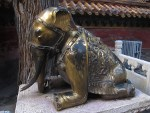 A bronze elephant (anatomically impossible pose).