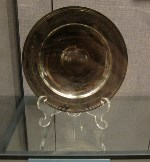 A tarnished silver dish given by Prime Minister Margaret Thatcher.