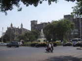 Plaza surrounded by gothic and saracenic buildings.