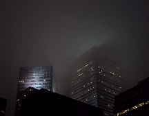 The Citicorp building glowing in the clouds.