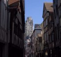 St. Ouen rises above a lane of timber houses